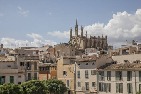 Low angle view of building and Palma Cathedral against sky at Balearic Islands, Spain - JMF00447