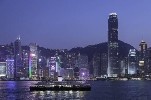 Star Ferry in Victoria Harbour at dusk, Hong Kong Island, Hong Kong, China, Asia - RHPLF05236