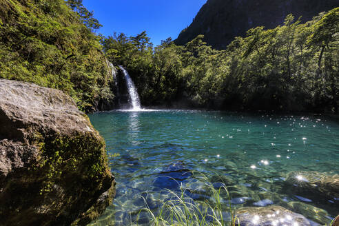 Waterfall, lake and blue sky, Petrohue Los Enamorados Trail, Vicente Perez Rosales National Park, Spring, Lakes District, Chile, South America - RHPLF05350
