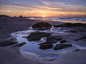 Sunrise on the shoreline with rocks and rock pools at Orcombe Point, Exmouth, Devon, England, United Kingdom, Europe - RHPLF06325
