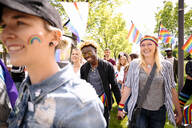 Cheerful students with rainbow flags at gay pride festival - HEROF38482