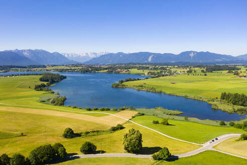 Riegsee lake in Bavarian Alps against clear sky, Germany - LHF00678