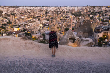Young woman looking to Goreme, Cappadocia, Turkey - KNTF03295