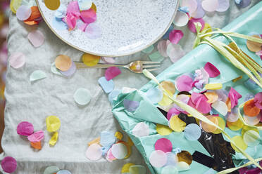 Present on table, decorated with confetti - MCF00218