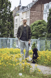 Man and his dog in a park - MCF00271