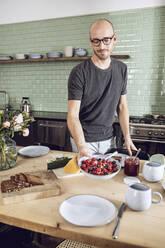 Man setting the breakfast table - MCF00277