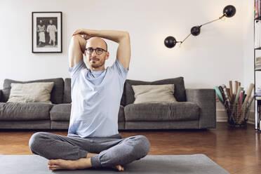 Man doing yoga at home - MCF00301