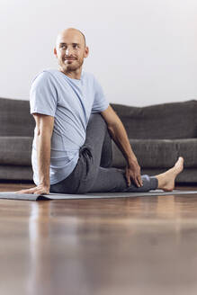 Man doing yoga at home - MCF00307