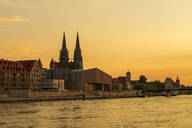 Saint Peter's Cathedral and buildings by Danube river against sky during sunset, Regensburg, Germany - LBF02674