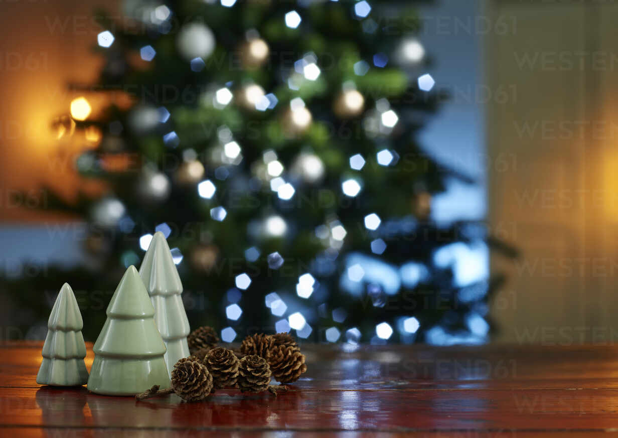 Close Up Of Small Christmas Trees With Pine Cones On Wooden Table At Home Kswf02093 Kai