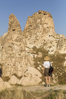Young woman, Uchisar castle, Cappadocia, Turkey - KNTF03312