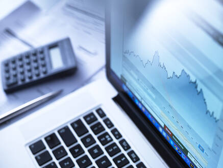 Share price data from a investors portfolio on a laptop computer screen - ABR00481
