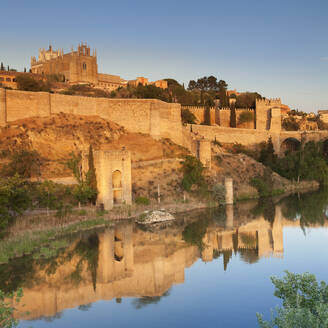 San Juan des los Reyes Monastery and town wall reflected in the Tajo River, Toledo, Castilla-La Mancha, Spain, Europe - RHPLF07450