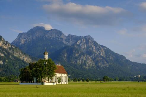 St. Coloman's Church on grassy land against mountain, Schwangau, Germany - LBF02680