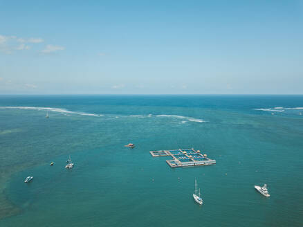 Aerial view of seascape against blue sky, Bali, Indonesia - KNTF03326