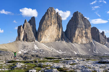 Rear view of boy with arms raised standing in front of Tre Cime Di Lavaredo, Italy - LOMF00885