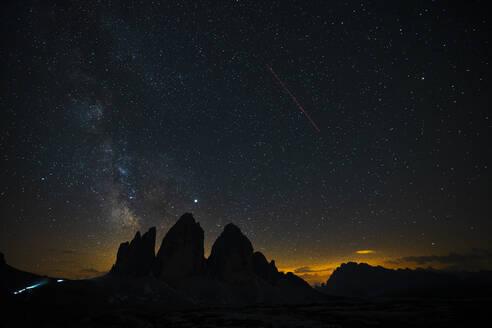 Scenic view of silhouette Tre Cime Di Lavaredo against star field at night, Italy - LOMF00894