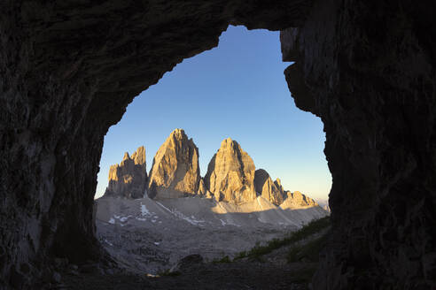 Scenic view of Tre Cime Di Lavaredo against clear sky seen through cave, Veneto, Italy - LOMF00900