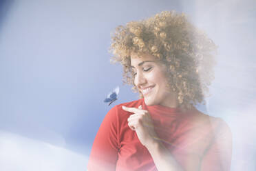 Smiling woman with flying butterfly, robot - KSHSF00007