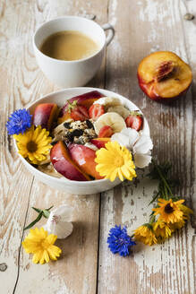 High angle view of food and drink with flowers on wooden table - EVGF03455