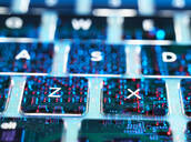 Double exposure of a laptop computer showing electronic components under the keyboard - ABRF00590