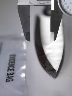 A knife being measured during forensic testing in the laboratory - ABRF00605
