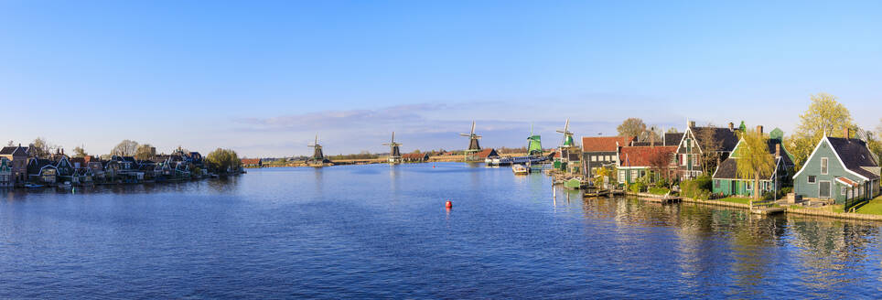 Panorama of wooden houses and windmills framed by the blue River Zaan, Zaanse Schans, North Holland, The Netherlands, Europe - RHPLF07772