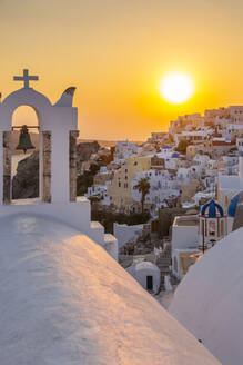 View of traditional blue domed churches and white houses at sunset in Oia, Santorini, Cyclades, Aegean Islands, Greek Islands, Greece, Europe - RHPLF08315