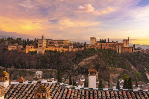 View of the Alhambra, UNESCO World Heritage Site, with the Sierra Nevada mountains in the background, at sunset, Granada, Andalucia, Spain, Europe - RHPLF08573