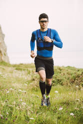 Trail runner training in nature, Ferrol, Spain - RAEF02295
