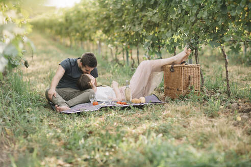 Young couple in love having picnic in the vineyards - ALBF01013