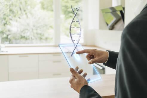 Hamd holding hologram of DNA model - KSHSF00014