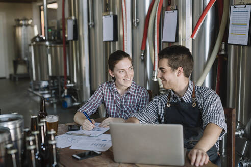 Young entrepreneurs working at a brewery - ALBF01052