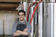Portrait of confident young brewer at a brewery - ALBF01073