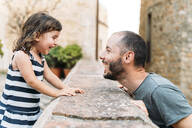 Happy little girl and father playing together outdoors - GEMF03131