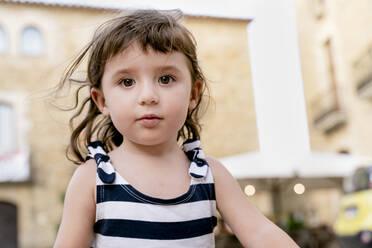 Portrait of cute little girl in summer wearing a striped dress - GEMF03134