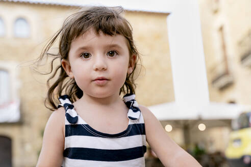 Portrait of cute little girl in summer wearing a striped dress - GEMF03134