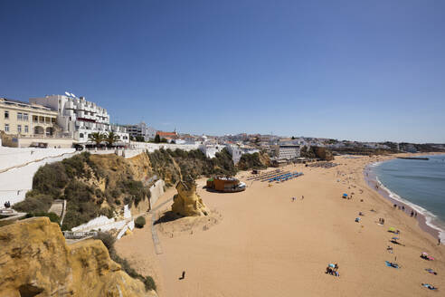 Scenic view of sandy beach against clear sky at Albufeira, Algarve, Portugal - WIF04023