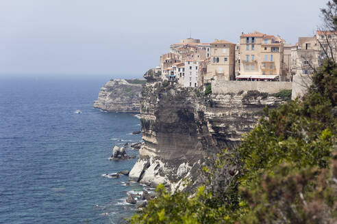 Old Town Bonifacio on White Limestone Cliffs by sea against clear sky at Corsica, France - ZCF00797
