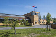 Low angle view of Fagus Factory against blue sky in city, Lower Saxony, Germany - RUN02905