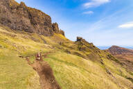Rear view of mature woman hiking at Quiraing, Isle of Skye, Highlands, Scotland, UK - SMAF01478