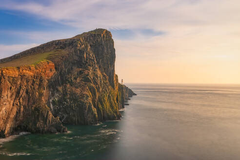 Neist Point Lighthouse by sea during sunset, Waterstein, Isle of Skye, Highlands, Scotland, UK - SMAF01490