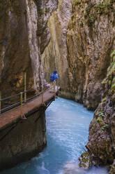 Senior woman on footbridge at Wasserfallsteig in Leutasch Gorge, Tyrol, Austria - SIEF09002