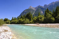 Scenic view of Isar River with Karwendel mountains in background against clear blue sky, Tyrol, Austria - SIEF09008