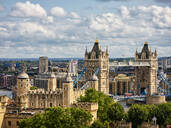 High angle view of Tower Bridge with cityscape in background against cloudy sky at London - HNF00818