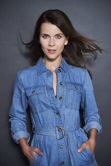 Portrait of attractive brunette woman wearing denim dress - PNEF01959