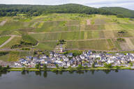 Drone shot of Zell town by Mosel River against sky, Germany - RUNF02922