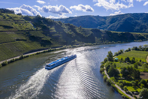 Aerial view of cruise ship on Mosel River against sky, Mehring, Germany - RUNF02928