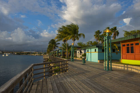 Houses on pier at Ponce harbor, Puerto Rico, Caribbean - RUNF02940