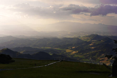 Scenic view of Apennine Mountains against cloudy sky at sunset, Umbria, Italy - LOMF00905
